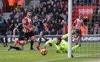 Shane Long (Southampton) and Ben Foster (West Brom) watch the ball go wide during the Premier League match between Southampton and West Bromwich Albion at St Mary's Stadium, Southampton, England on 31 December 2016.