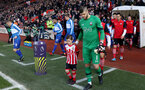 Fraser Forster with the matchday mascot during the Premier League match between Southampton and Leicester City at St Mary's Stadium, Southampton, England on 22 January 2017.