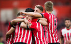 team celebrate with alfie jones during Southampton FC U23 v Liverpool U23, at St Mary's stadium, Southampton, 10th April 2017, pic by Naomi Baker/Southampton FC
