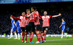 Southampton players celebrate after Oriol Romeu equalises during the Premier League match between Chelsea and Southampton at Stamford Bridge, London. Photo by Matt Watson/SFC/Digital South.
