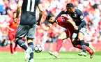 Emre Can(left) and Sofiane Boufal during the Premier League match between Liverpool and Southampton at Anfield, Liverpool. Photo by Matt Watson/SFC/Digital South.