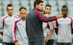 MUNICH, GERMANY - SEPTEMBER 18:  Mauricio Pellegrino, head coach of Valencia talks to his players prior a Valencia CF training session ahead of their UEFA Champions League group F match against FC Bayern Muenchen, at Allianz Arena on September 18, 2012 in Munich, Germany.  (Photo by Alexander Hassenstein/Bongarts/Getty Images)