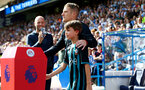 HUDDERSFIELD, ENGLAND - AUGUST 26: Steven Davis leads the team out with the matchday mascot during the Premier League match between Huddersfield Town and Southampton at the John Smith Stadium on August 26, 2017 in Huddersfield, England. (Photo by Matt Watson/Southampton FC via Getty Images)