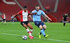 SOUTHAMPTON, ENGLAND - OCTOBER 16: Marcus Barnes of Southampton(left) and Kyle Cameron during the Premier League 2 match between Southampton U23 and Newcastle United U23, at St Mary's Stadium on October 16, 2017 in Southampton, England. (Photo by Matt Watson/Southampton FC via Getty Images)