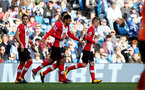 BRIGHTON, ENGLAND - OCTOBER 29: Southampton's Steven Davis(right) celebrates after opening the scoring during the Premier League match between Brighton and Hove Albion and Southampton at the Amex Stadium on October 29, 2017 in Brighton, England. (Photo by Matt Watson/Southampton FC via Getty Images)