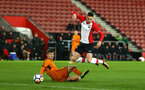 SOUTHAMPTON, ENGLAND - DECEMBER 14: Will Smallbone (right) of Southampton FC goes down during the match between Southampton FC vs Wolverhampton Wanders for the FA U18's Youth Cup on December 14, 2017 in Southampton, England. (Photo by James Bridle - Southampton FC/Southampton FC via Getty Images)