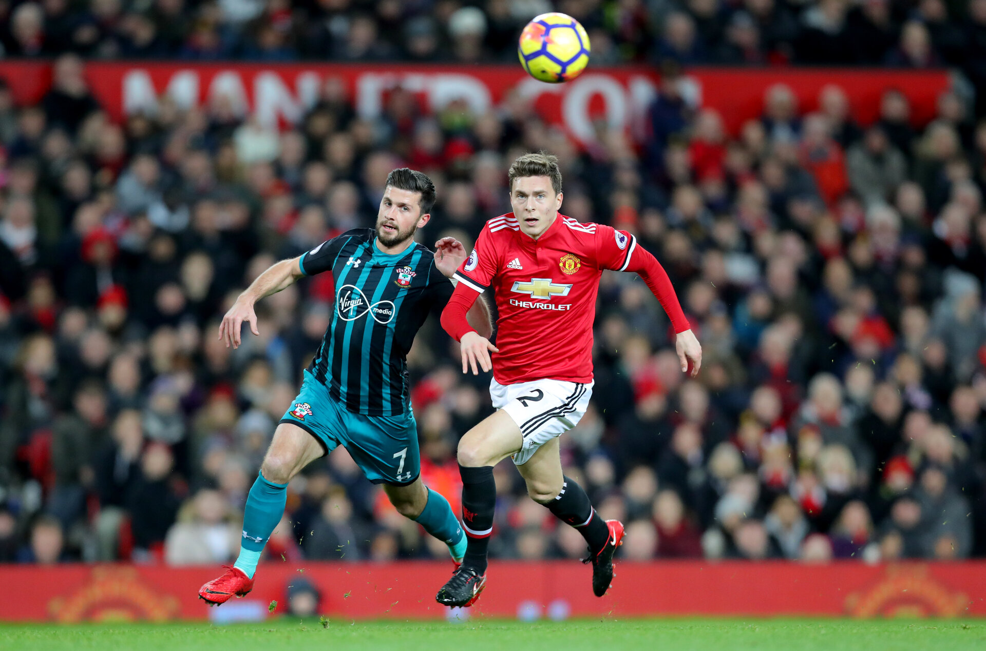MANCHESTER, ENGLAND - DECEMBER 30: Southampton's Shane Long(L) and Victor Lindelof of Manchester United during the Premier League match between Manchester United and Southampton at Old Trafford on December 30, 2017 in Manchester, England. (Photo by Matt Watson/Southampton FC via Getty Images)