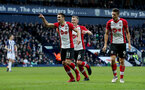 WEST BROMWICH, ENGLAND - FEBRUARY 17: Dusan Tadic(R) of Southampton celebrates scoring his teams second goal, with team mate Guido Carrillo(R) and James Ward-Prowse(centre) during the Emirates FA Cup fifth round match between West Bromwich Albion and Southampton at The Hawthorns on February 17, 2018 in West Bromwich, England. (Photo by Matt Watson/Southampton FC via Getty Images)