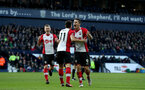WEST BROMWICH, ENGLAND - FEBRUARY 17: Dusan Tadic(centre), James Ward-Prowse(L) and Guido Carrillo(R) of Southampton celebrate during the Emirates FA Cup fifth round match between West Bromwich Albion and Southampton at The Hawthorns on February 17, 2018 in West Bromwich, England. (Photo by Matt Watson/Southampton FC via Getty Images)