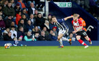 WEST BROMWICH, ENGLAND - FEBRUARY 17: Josh Sims(R) of Southampton and Johnny Evan(L)s of West Bromwich Albion during the Emirates FA Cup fifth round match between West Bromwich Albion and Southampton at The Hawthorns on February 17, 2018 in West Bromwich, England. (Photo by Matt Watson/Southampton FC via Getty Images)