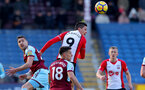 BURNLEY, ENGLAND - FEBRUARY 24: Guido Carrillo(R) of Southampton and Stephen Ward(L) of Burnley during the Premier League match between Burnley and Southampton at Turf Moor on February 24, 2018 in Burnley, England. (Photo by Matt Watson/Southampton FC via Getty Images)