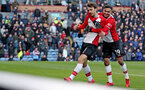 BURNLEY, ENGLAND - FEBRUARY 24: Manolo Gabbiadini(L) of Southampton celebrtes with team mate Sofiane Boufal during the Premier League match between Burnley and Southampton at Turf Moor on February 24, 2018 in Burnley, England. (Photo by Matt Watson/Southampton FC via Getty Images)