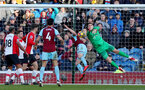 BURNLEY, ENGLAND - FEBRUARY 24: Alex McCarthy(R) of Southampton is beaten to the ball by Ashley Barnes of Burnley who scores during the Premier League match between Burnley and Southampton at Turf Moor on February 24, 2018 in Burnley, England. (Photo by Matt Watson/Southampton FC via Getty Images)