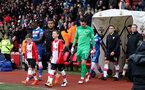 SOUTHAMPTON, ENGLAND - MARCH 03: Ryan Bertrand with the match day mascots of Southampton during the Premier League match between Southampton and Stoke City at St Mary's Stadium on March 3, 2018 in Southampton, England. (Photo by Matt Watson/Southampton FC via Getty Images)