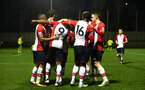 SOUTHAMPTON, ENGLAND - MARCH 12: Southampton FC celebrate after Michael Obafemi scores during the PL2 match between Southampton FC and Norwich City FC at Staplewood Training Ground on March 12, 2018 in Southampton, England. (Photo by James Bridle - Southampton FC/Southampton FC via Getty Images)