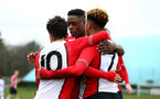 SOUTHAMPTON, ENGLAND - MARCH 17: LtoR Sean Brennan, Jonathan Afolabi, Enzo Robise scores during the U18's match between Southampton FC and Reading FC at Staplewood Complex on March 16, 2018 in Southampton, England. (Photo by James Bridle - Southampton FC/Southampton FC via Getty Images)