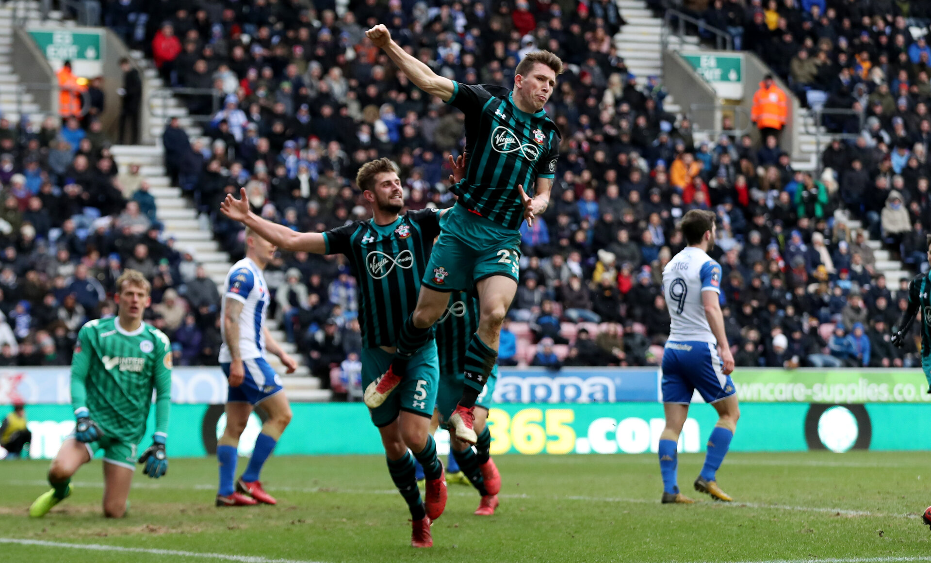 WIGAN, ENGLAND - MARCH 18: Pierre-Emile Hojbjerg of Southampton celebrates after putting his team 1-0 up during the FA Cup Quarter Final match between Wigan Athletic and Southampton FC at the DW Stadium on March 18, 2018 in Wigan, England. (Photo by Matt Watson/Southampton FC via Getty Images)