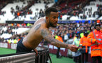 LONDON, ENGLAND - MARCH 31: Ryan Bertrand gives his match shirt and Captains band to Southampton FC supports after the Premier League match between West Ham United and Southampton at London Stadium on March 31, 2018 in London, England. (Photo by James Bridle - Southampton FC/Southampton FC via Getty Images)