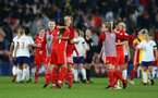 SOUTHAMPTON, ENGLAND - APRIL 06: Wales celebrate after the final whistle is blown for the England Lionesses vs Wales Womens match at St Mary's Stadium on April 6, 2018 in Southampton, England. (Photo by James Bridle - Southampton FC/Southampton FC via Getty Images)