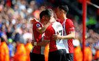 SOUTHAMPTON, ENGLAND - APRIL 14: Dusan Tadic of Southampton FC (left) scores during the Premier League match between Southampton and Chelsea at St Mary's Stadium on April 14, 2018 in Southampton, England. (Photo by Chris Moorhouse/Southampton FC via Getty Images)