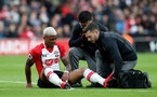 SOUTHAMPTON, ENGLAND - APRIL 28: Mario Lemina of Southampton is treated by Physio Kevin Mulholland during the Premier League match between Southampton and AFC Bournemouth at St Mary's Stadium on April 28, 2018 in Southampton, England. (Photo by Matt Watson/Southampton FC via Getty Images)