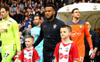 SOUTHAMPTON, ENGLAND - APRIL 28: Ryan Bertrand (middle) with Southampton FC mascots ahead of the Premier League match between Southampton and AFC Bournemouth at St Mary's Stadium on April 28, 2018 in Southampton, England. (Photo by James Bridle - Southampton FC/Southampton FC via Getty Images)