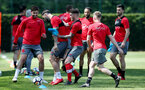 SOUTHAMPTON, ENGLAND - MAY 07: Callum Slattery challenges Charlie Austin during a Southampton FC training session at the Staplewood Campus on May 7, 2018 in Southampton, England. (Photo by Matt Watson/Southampton FC via Getty Images)