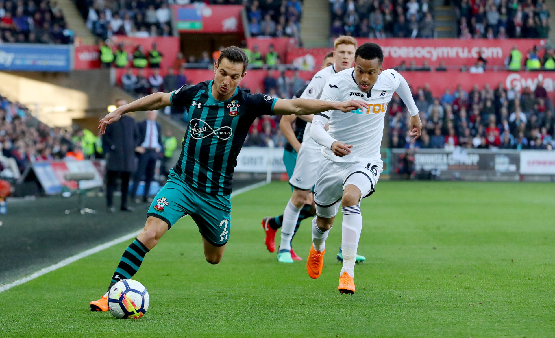 SWANSEA, WALES - MAY 08: Cedric(L) of Southampton and Martin Olsson(R) of swansea during the Premier League match between Swansea City and Southampton at Liberty Stadium on May 8, 2018 in Swansea, Wales. (Photo by Matt Watson/Southampton FC via Getty Images)