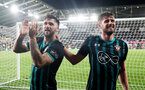 SWANSEA, WALES - MAY 08: Charlie Austin(L) and Jack Stephens celebrate after winning the Premier League match between Swansea City and Southampton at Liberty Stadium on May 8, 2018 in Swansea, Wales. (Photo by Matt Watson/Southampton FC via Getty Images)