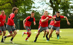 SOUTHAMPTON, ENGLAND - MAY 11: Southampton FC players, Manolo Gabbiadini, Will Smallbone, James Ward-Prowse, Guido Carrillo during a warm up exercise ahead of a training session at Staplewood Complex on May 11, 2018 in Southampton, England. (Photo by James Bridle - Southampton FC/Southampton FC via Getty Images)