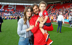 SOUTHAMPTON, ENGLAND - MAY 13: Manolo Gabbiadini of Southampton FC  (middle) with his wife and son during the lap of appreciation after the Premier League match between Southampton and Manchester City at St Mary's Stadium on May 13, 2018 in Southampton, England. (Photo by James Bridle - Southampton FC/Southampton FC via Getty Images)