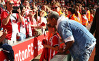 SOUTHAMPTON, ENGLAND - MAY 13: Mario Lemina (right) of Southampton FC poses with young fans for photos during the Premier League match between Southampton and Manchester City at St Mary's Stadium on May 13, 2018 in Southampton, England. (Photo by James Bridle - Southampton FC/Southampton FC via Getty Images)