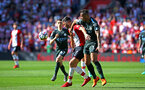 SOUTHAMPTON, ENGLAND - MAY 13: Shane Long (left) of Southampton FC takes on Danilo of Manchester City (right) during the Premier League match between Southampton and Manchester City at St Mary's Stadium on May 13, 2018 in Southampton, England. (Photo by James Bridle - Southampton FC/Southampton FC via Getty Images)