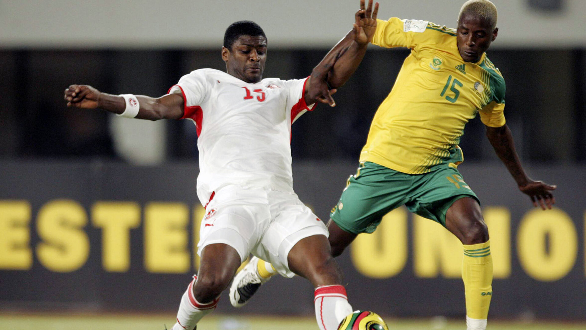 TAMALE, GHANA - JANUARY 27:  Radhi Jaidi and Sibusiso Zuma during the Group D African Cup Of Nations match between South Africa and Tunisia held at the Tamale Stadium on January 27, 2008 in Tamale, Ghana. (Photo by Lefty Shivambu/Gallo Images/Getty Images)