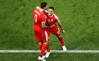 KALININGRAD, RUSSIA - JUNE 22:  Aleksandar Mitrovic of Serbia celebrates with teammate Dusan Tadic after scoring his team's first goal during the 2018 FIFA World Cup Russia group E match between Serbia and Switzerland at Kaliningrad Stadium on June 22, 2018 in Kaliningrad, Russia.  (Photo by Clive Rose/Getty Images)