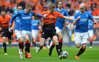 GLASGOW, SCOTLAND - APRIL 12:  Steven Smith (L) and Nicky Law of Rangers chases down Stuart Armstrong of Dundee United during the William Hill Scottish Cup Semi Final between Rangers and Dundee United at Ibrox Stadium on April 12, 2014 in Glasgow, Scotland. (Photo by Mark Runnacles/Getty Images)