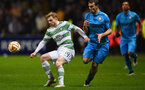 GLASGOW, SCOTLAND - FEBRUARY 19:  Stuart Armstrong of Celtic shields the ball from Hugo Campagnaro of Inter Milan during the UEFA Europa League Round of 32 first leg match between Celtic FC and FC Internazionale Milano at Celtic Park Stadium on February 19, 2015 in Glasgow, United Kingdom.  (Photo by Laurence Griffiths/Getty Images)