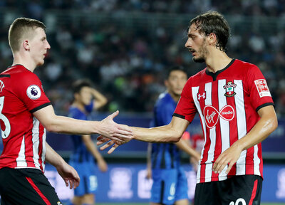 Saints edge past Jiangsu Suning