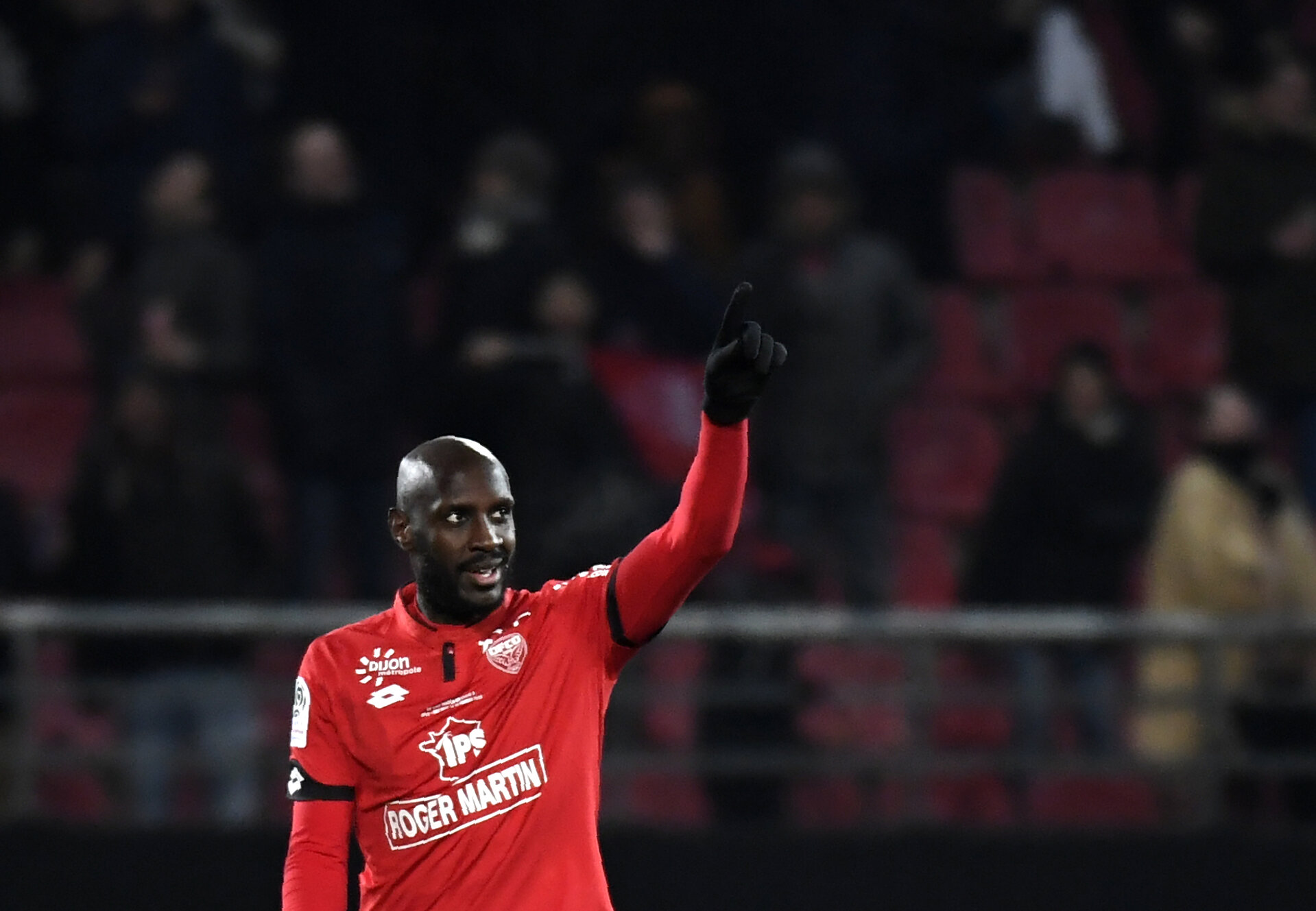 Dijon's Cap Verdean forward Julio Tavares reacts after scoring a goal during the French L1 football match between Dijon FCO and OGC Nice on February 10, 2018 at the Gaston Gerard stadium in Dijon, central-eastern France.   / AFP PHOTO / PHILIPPE DESMAZES        (Photo credit should read PHILIPPE DESMAZES/AFP/Getty Images)