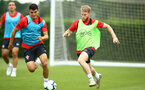 SOUTHAMPTON, ENGLAND - JULY 17: LtoR Mohamed Elyounoussi, Josh Sims during a Southampton FC training session at Staplewood Complex on July 17, 2018 in Southampton, England. (Photo by James Bridle - Southampton FC/Southampton FC via Getty Images)