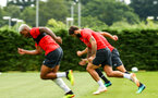 SOUTHAMPTON, ENGLAND - JULY 18: Mario Lemina, Charlie Austin, during a Southampton FC training session at Staplewood Complex on July 18, 2018 in Southampton, England. (Photo by James Bridle - Southampton FC/Southampton FC via Getty Images)