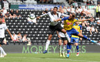 DERBY, ENGLAND - JULY 21: Jannik Vestergaard(R) of Southampton beats Curtis Davies(L) to head at goal during the pre-season friendly match between Derby County and Southampton at Pride Park on July 21, 2018 in Derby, England. (Photo by Matt Watson/Southampton FC via Getty Images)