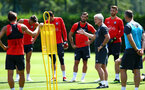 SOUTHAMPTON, ENGLAND - AUGUST 03: Mark Hughes (right) speaks with the Southampton FC players during a Southampton FC training session at Staplewood Complex on August 3, 2018 in Southampton, England. (Photo by James Bridle - Southampton FC/Southampton FC via Getty Images)