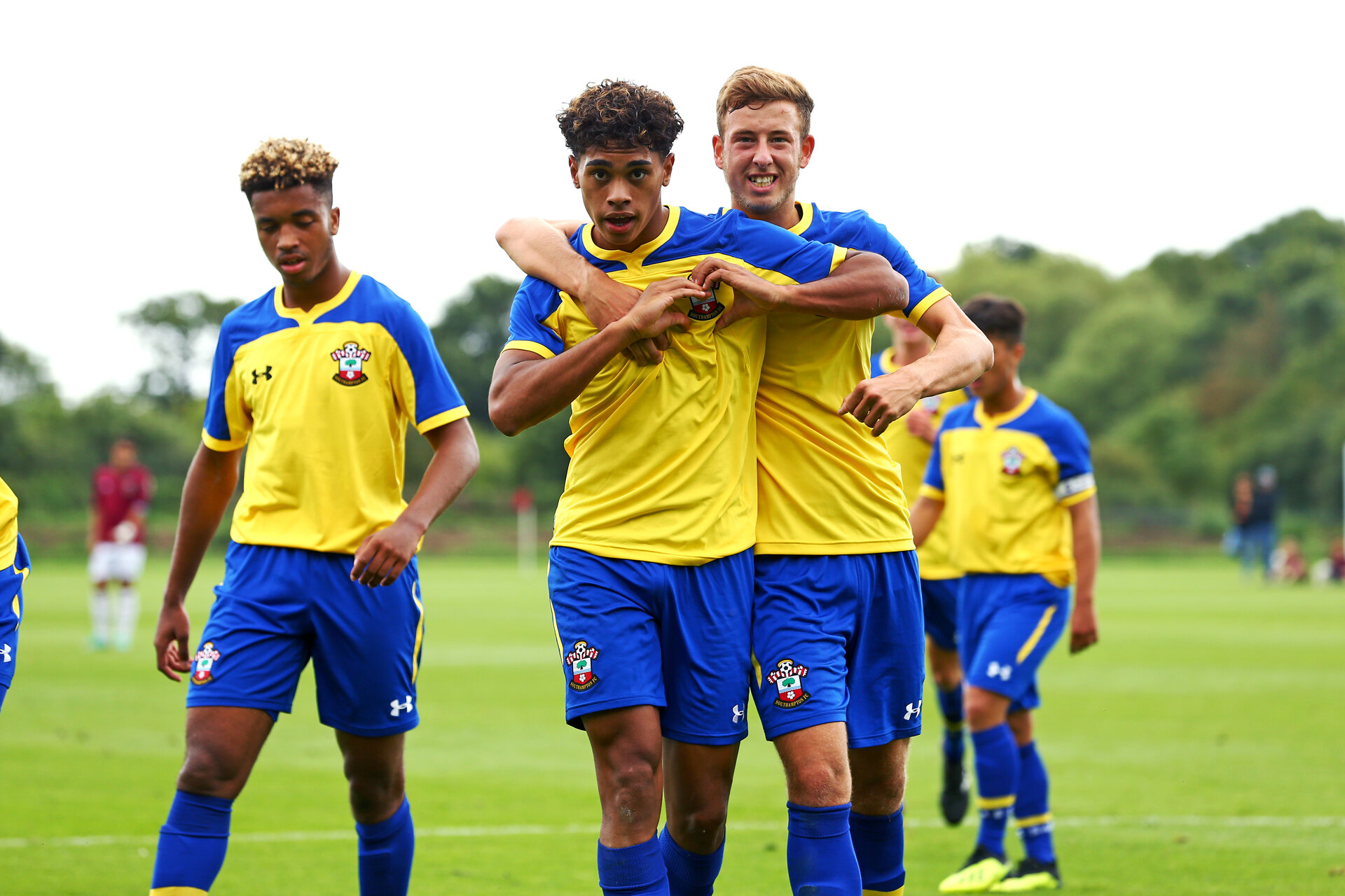 LONDON, ENGLAND - AUGUST 18: Christian Norton (middle) celebrates after scoring during an U18 Premier League match between  Southampton FC and West Ham United at Little Heath Training Ground on August 16, 2018 in London, England. (Photo by James Bridle - Southampton FC/Southampton FC via Getty Images)