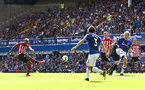 LIVERPOOL, ENGLAND - AUGUST 18: Mario Lemina of Southampton shoots at goal during the Premier League match between Everton FC and Southampton FC at Goodison Park on August 18, 2018 in Liverpool, United Kingdom. (Photo by Matt Watson/Southampton FC via Getty Images)
