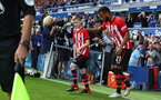 LIVERPOOL, ENGLAND - AUGUST 18: Ryan Bertrand of Southampton leads the teams out with the matchday mascot during the Premier League match between Everton FC and Southampton FC at Goodison Park on August 18, 2018 in Liverpool, United Kingdom. (Photo by Matt Watson/Southampton FC via Getty Images)
