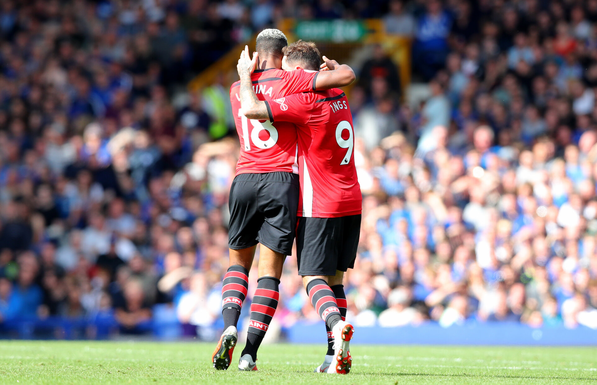 LIVERPOOL, ENGLAND - AUGUST 18: Mario Lemina(L) and Danny Ings of Southampton during the Premier League match between Everton FC and Southampton FC at Goodison Park on August 18, 2018 in Liverpool, United Kingdom. (Photo by Matt Watson/Southampton FC via Getty Images)