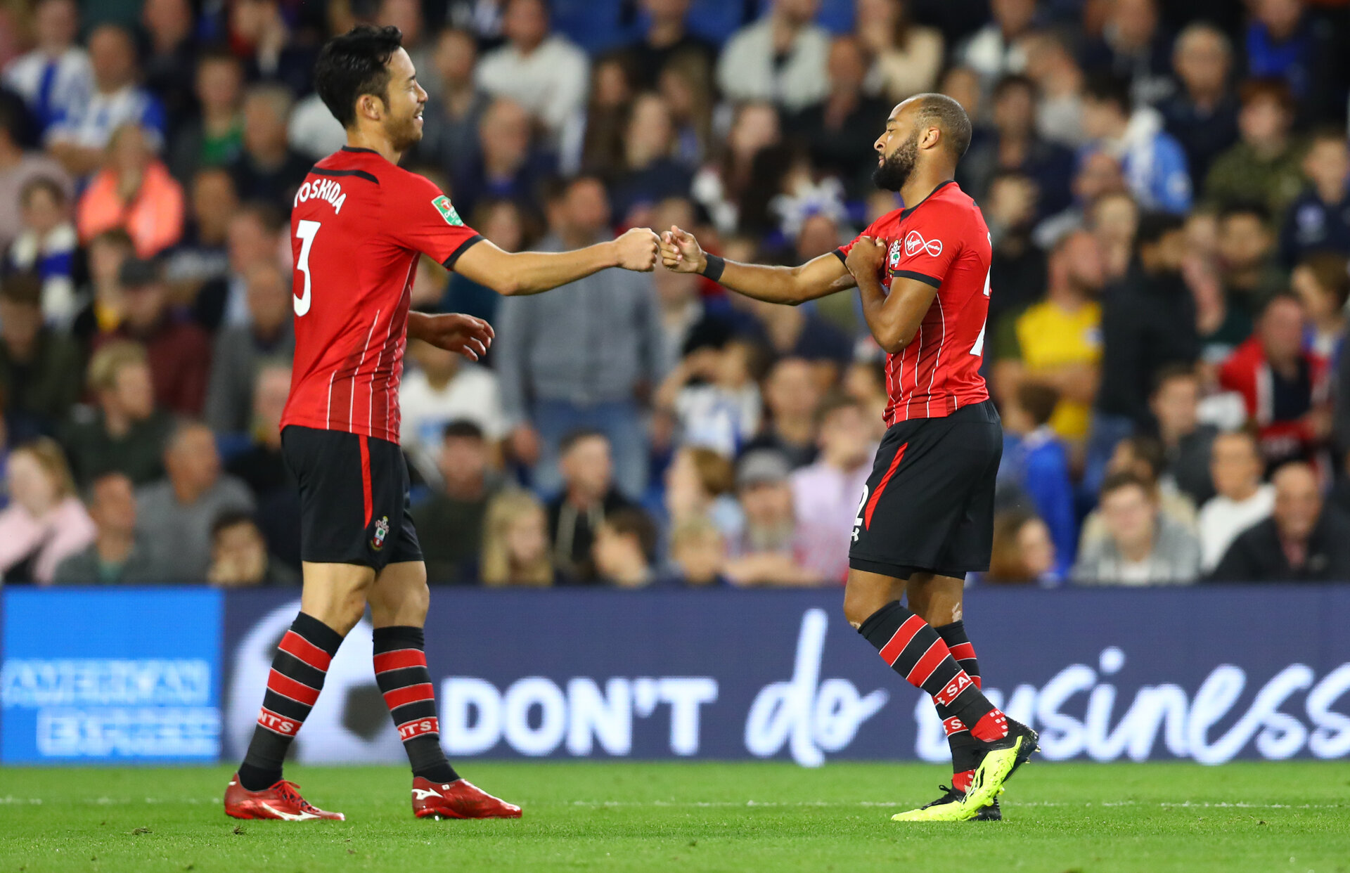 BRIGHTON, ENGLAND - AUGUST 28: Maya Yoshida(L) and Nathan Redmond of Southampton during the Carabao Cup Second Round match between Brighton & Hove Albion and Southampton at American Express Community Stadium on August 28, 2018 in Brighton, England. (Photo by Matt Watson/Southampton FC via Getty Images)