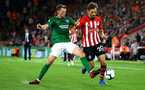 SOUTHAMPTON, ENGLAND - SEPTEMBER 17: Manolo Gabbiadini of Southampton FC (right) tackled by Shane Duffy of Brighton Hove Albion (left) during the Premier League match between Southampton FC and Brighton & Hove Albion at St Mary's Stadium on September 17, 2018 in Southampton, United Kingdom. (Photo by James Bridle - Southampton FC/Southampton FC via Getty Images)