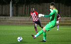 SOUTHAMPTON, ENGLAND - SEPTEMBER 21: Jonathan Afolabi (left) tries to intercept the keeper during the PL2 match between Southampton FC and Aston Villa FC at Staplewood Training Ground on September 21, 2018 in Southampton, United Kingdom. (Photo by James Bridle - Southampton FC/Southampton FC via Getty Images)